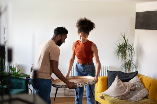 African American couple moving into a new home