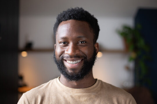 Portrait of happy African American male at home