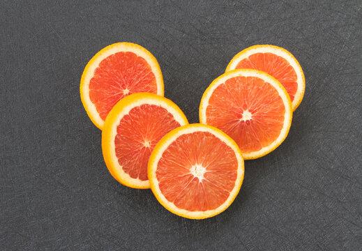 Sliced of Orange fruit stackek on background