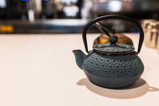 Teapots on bar counter