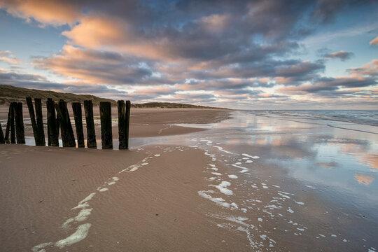 sunrise on North sea by breakwater
