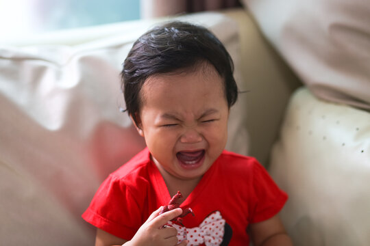 Portrait of angry Asian little baby girl.