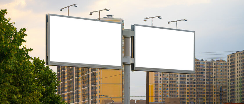 Two large outdoor billboards in Commuter town