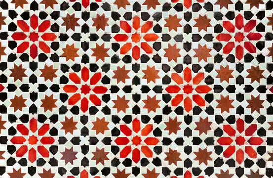 Decorative background in arabic mosaic style. Morocco style star tiles. Composition of star tiles in red, brown and black color on a white background.