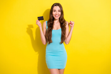 Photo of hooray brunette hairdo young lady hold card wear teal dress isolated on vivid yellow color background Wall mural