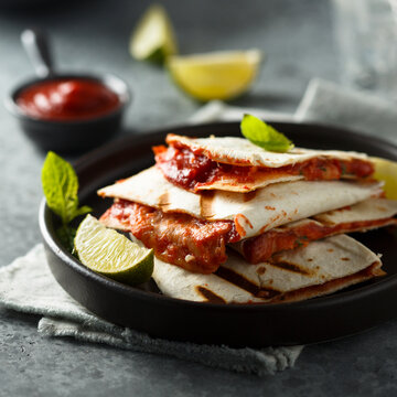 Traditional homemade Mexican quesadilla with tomatoes and cheese