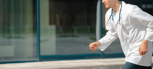 Obraz excited doctor confidently runs to the patient . - fototapety do salonu
