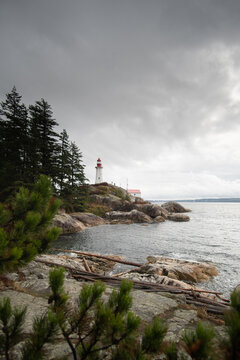 Lighthouse on a rocky coast in West Vancouver during cloudy weathe
