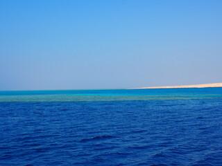 Obraz morski niebo fala krajobraz piasek - fototapety do salonu