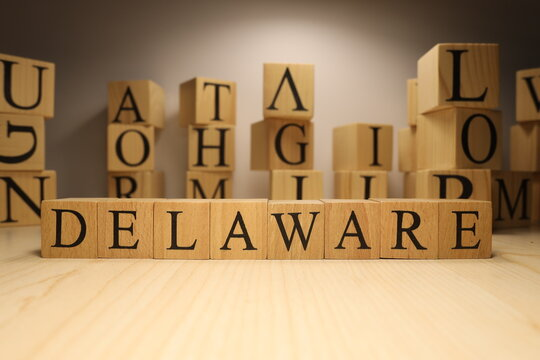 The word Delaware was created from wooden letter cubes. Cities and words.