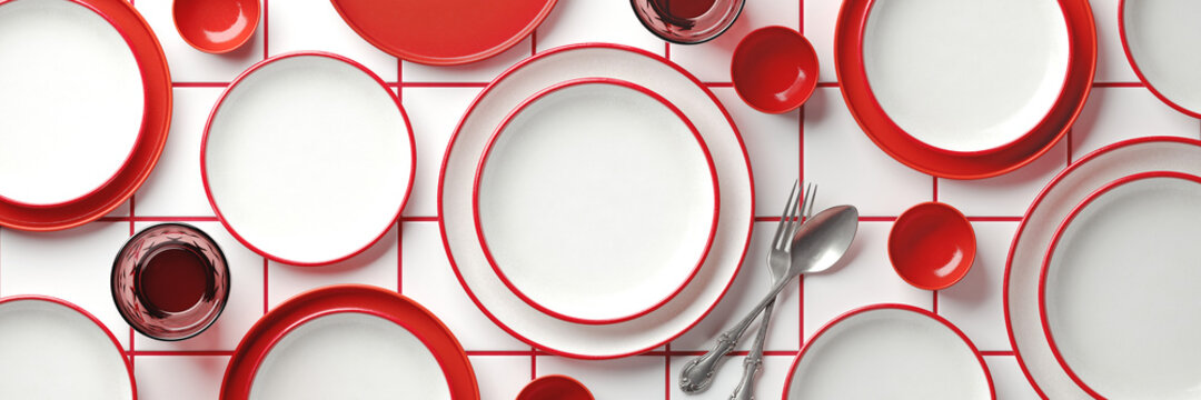 Mockup background for food stylist presentation. Top view of empty plates on white ceramic tile with red grout background. 3d render illustration. Clipping path of each element included.