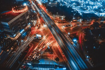 Obraz Busy highway road junction in metropolis city center at night . Transportation and infrastructure concept . - fototapety do salonu
