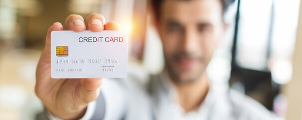 Obraz Close up credit card in the hand of businessman,  purchase and payment concept. - fototapety do salonu