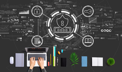 Fototapeta Cyber security theme with person using a laptop obraz
