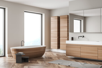 Fototapeta Modern bathroom interior with wood and stone decor elements and big window. Concept of contemporary design and spa relaxation. obraz
