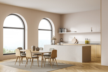 Fototapeta Corner view of the light double sided kitchen with arch windows, table obraz
