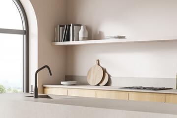 Fototapeta Close corner view of the double sided kitchen cabinet, light beige obraz