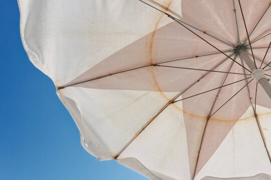 Looking up to the sky under a beach umbrella.