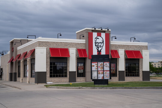 Gillette, Wyoming - June 26, 2021: Sign and spinning bucket for a KFC (Kentucky Fried Chicken) fast food restaurant