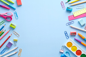 Fototapeta Flat lay colorful school supplies on blue background. Back to school concept. Top view, overhead. obraz