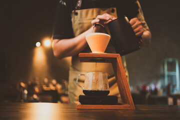 Fototapeta barista brewing a coffee filter drip in the morning, beverage drink with fresh black espresso aroma, hot drink in cup of cafes, brown caffeine in bar shop background obraz