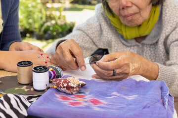 Fototapeta Elderly woman and daughter in the needle crafts occupational therapy for Alzheimer's or dementia obraz