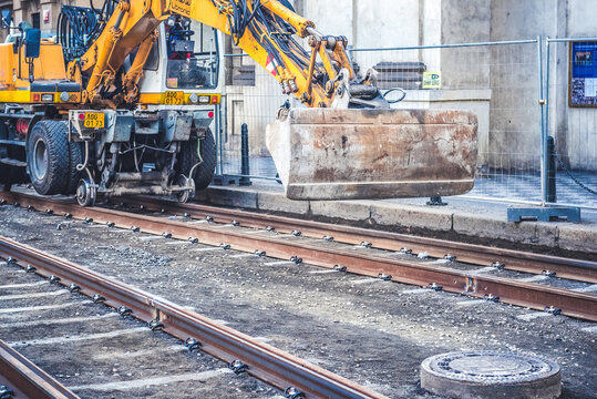 Engineer railway under inspection and checking construction railway switch and checking work on railroad station