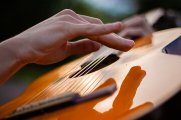 Fototapeta Young man playing a guitar hands close up obraz