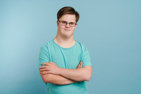 Young man with down syndrome smiling and looking at camera