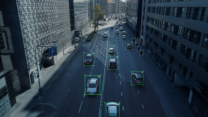 Obraz Aerial Drone Shot: Autonomous Self Driving Cars Moving Through City. Concept: Artificial Intelligence Scans Cars and Pedestrians, Following Movement and Showing Data. - fototapety do salonu