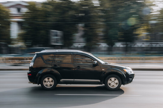 Ukraine, Kyiv - 16 July 2021: Black Mitsubishi Outlander car moving on the street. Editorial