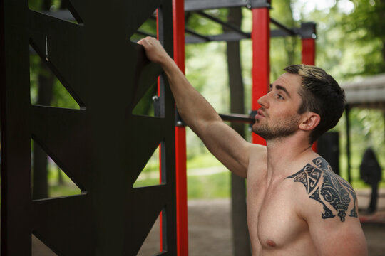 Close up of a handsome muscular man resting during outdoor workout