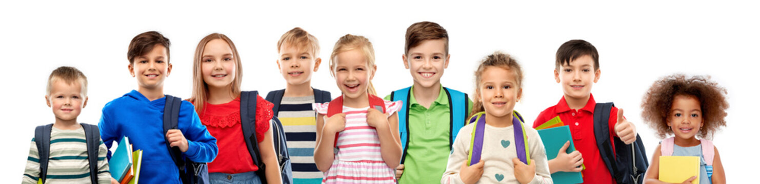 education, learning and people concept - group of happy smiling international children with school bags over white background