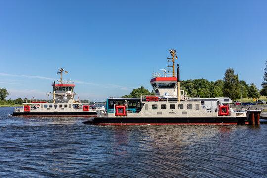 SCHACHT-AUDORF, GERMANY - JUNE 14, 2021: Kiel Canal ferries MEMEL and KÜSTRIN at crossing point Schacht-Audorf - Nobiskrug
