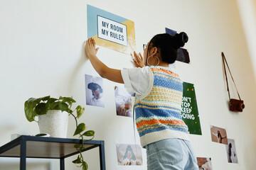 Fototapeta Portrait of modern teenage girl hanging My room my rules poster on wall in room, copy space obraz