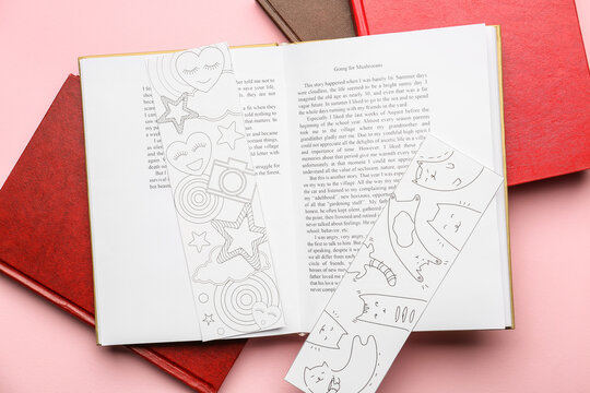 Books with cute bookmarks on color background