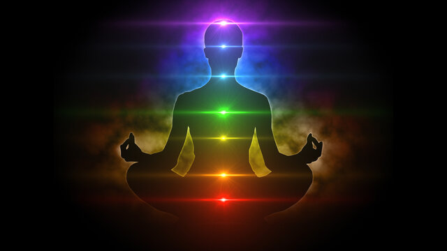Meditating figure in lotus pose with colorful aura and chakras