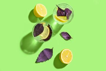 Fototapeta Glasses of tasty lemonade with basil on color background obraz