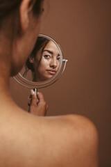 Fototapeta Woman looking in the mirror obraz