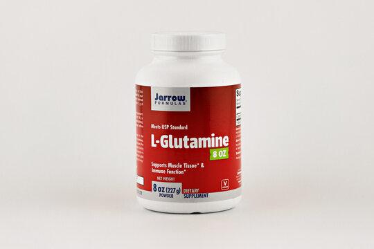 l-glutamine powder supplement in the jar. dietary supplement editorial photo
