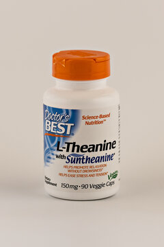 l-theanine capsules in the jar. dietary supplement editorial photo