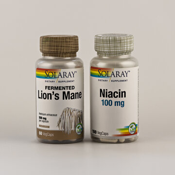 lion's mane capsules and niacin capsules in the jar. dietary supplement editorial photo