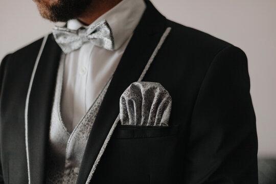 Elegant gentleman in tuxedo with pocket square