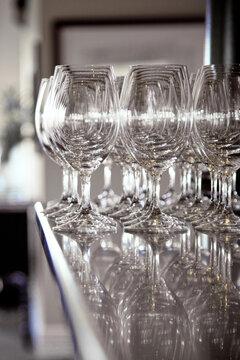 Clean wine glasses on a bar