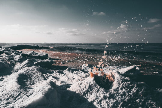 splashes of the frozen sea on snowy hummocks