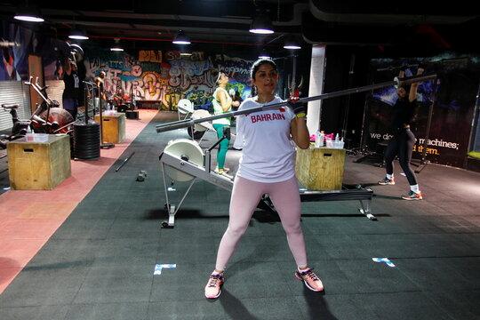 Shaikha al Shaiba, a Bahraini amputee and cancer survivor, exercises at a gym in Manama