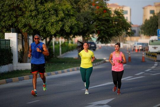 Shaikha al Shaiba, a Bahraini amputee and cancer survivor, runs during her training in Muharraq