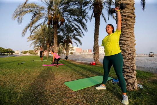 Shaikha al Shaiba, a Bahraini amputee and cancer survivor, exercises at the park in Muharraq