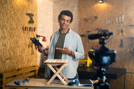 DIY carpenter filming a blog about drill