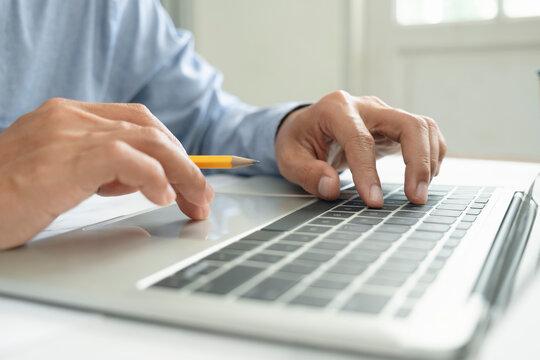 Closeup hand coding programing computer software.